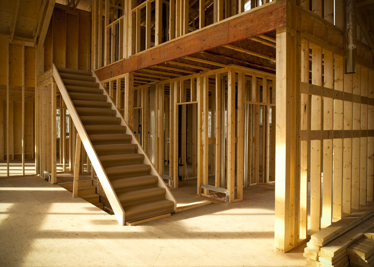 interior of house under construction wood framing studs